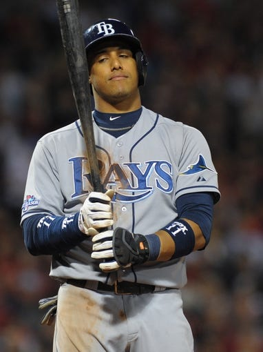 Oct 5, 2013; Boston, MA, USA; Tampa Bay Rays shortstop Yunel Escobar (11) bats during the eighth inning in game two of the American League divisional series playoff baseball game against the Boston Red Sox at Fenway Park. Mandatory Credit: Bob DeChiara-USA TODAY Sports