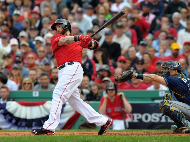 Oct 4, 2013; Boston, MA, USA; Boston Red Sox left fielder Jonny Gomes (5) bats during the second inning in game one of the American League divisional series playoff baseball game against the Tampa Bay Rays at Fenway Park. Mandatory Credit: Bob DeChiara-USA TODAY Sports
