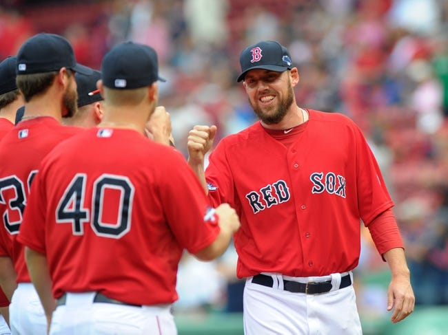 Oct 4, 2013; Boston, MA, USA; Boston Red Sox starting pitcher John Lackey (41) is introduced to the crowd prior to game one of the American League divisional series playoff baseball game against the Tampa Bay Rays at Fenway Park. Mandatory Credit: Bob DeChiara-USA TODAY Sports