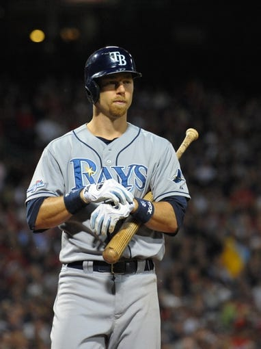 Oct 5, 2013; Boston, MA, USA; Tampa Bay Rays second baseman Ben Zobrist (18) adjusts his batting glove during the fifth inning in game two of the American League divisional series playoff baseball game against the Boston Red Sox at Fenway Park. Mandatory Credit: Bob DeChiara-USA TODAY Sports