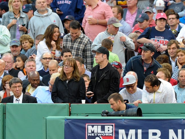 Oct 4, 2013; Boston, MA, USA; American actor John Travolta attends game one of the American League divisional series playoff baseball game between the Boston Red Sox and the Tampa Bay Rays at Fenway Park. Mandatory Credit: Bob DeChiara-USA TODAY Sports