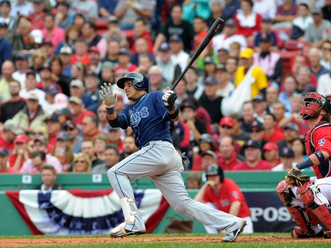 Oct 4, 2013; Boston, MA, USA; Tampa Bay Rays shortstop Yunel Escobar (11) bats during the second inning in game one of the American League divisional series playoff baseball game against the Boston Red Sox at Fenway Park. Mandatory Credit: Bob DeChiara-USA TODAY Sports