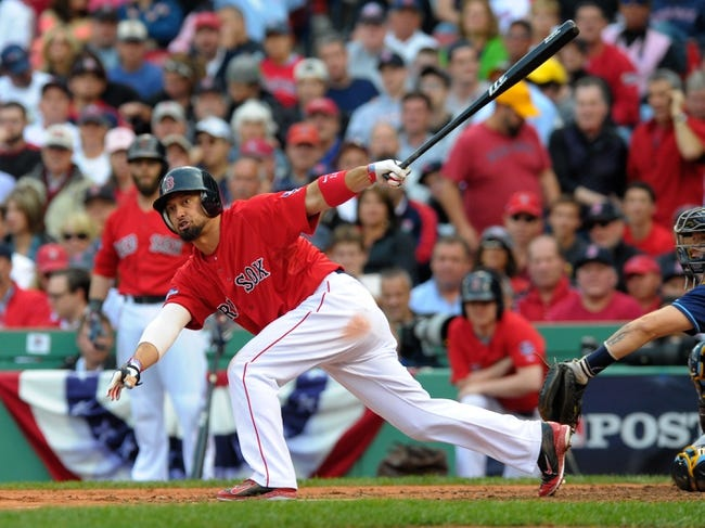 Oct 4, 2013; Boston, MA, USA; Boston Red Sox right fielder Shane Victorino (18) bats during the third inning in game one of the American League divisional series playoff baseball game against the Tampa Bay Rays at Fenway Park. Mandatory Credit: Bob DeChiara-USA TODAY Sports