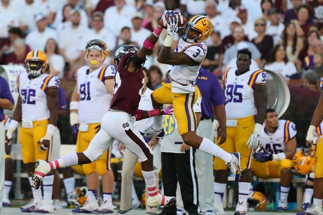 Oct 5, 2013; Starkville, MS, USA; LSU Tigers wide receiver Odell Beckham (3) receives a pass over Mississippi State Bulldogs defensive back Taveze Calhoun (23) during the game at Davis Wade Stadium.  LSU Tigers defeated the Mississippi State Bulldogs 59-26.  Mandatory Credit: Spruce Derden-USA TODAY Sports