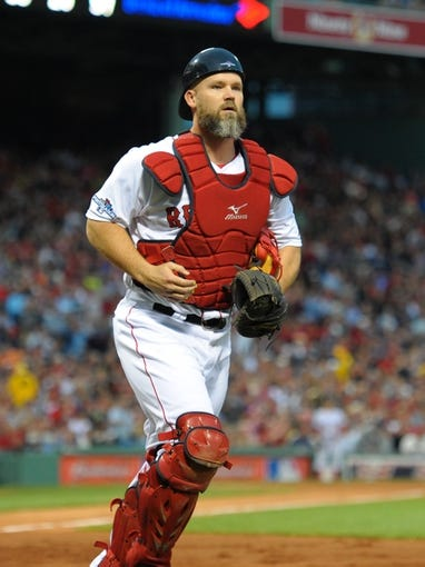 Oct 5, 2013; Boston, MA, USA; Boston Red Sox catcher David Ross (3) heads to the dugout against the Tampa Bay Rays during the second inning in game two of the American League divisional series playoff baseball game at Fenway Park. Mandatory Credit: Bob DeChiara-USA TODAY Sports