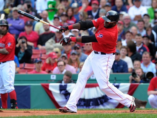 Oct 4, 2013; Boston, MA, USA; Boston Red Sox designated hitter David Ortiz (34) bats during the first inning in game one of the American League divisional series playoff baseball game against the Tampa Bay Rays at Fenway Park. Mandatory Credit: Bob DeChiara-USA TODAY Sports