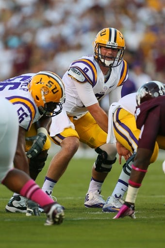 Oct 5, 2013; Starkville, MS, USA; LSU Tigers quarterback Zach Mettenberger (8) prepares to take a snap during the game against the Mississippi State Bulldogs at Davis Wade Stadium.  LSU Tigers defeated the Mississippi State Bulldogs 59-26.  Mandatory Credit: Spruce Derden-USA TODAY Sports