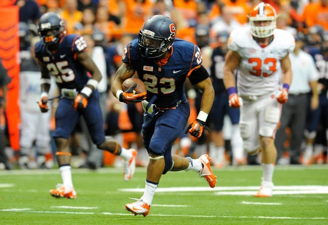 Oct 5, 2013; Syracuse, NY, USA; Syracuse Orange running back Prince-Tyson Gulley (23) runs with the ball during the third quarter against the Clemson Tigers at the Carrier Dome.  Clemson defeated Syracuse 49-14.  Mandatory Credit: Rich Barnes-USA TODAY Sports