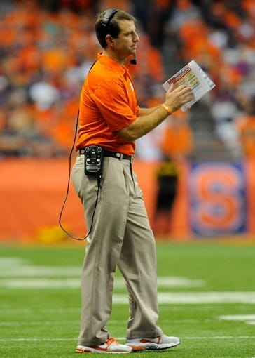 Oct 5, 2013; Syracuse, NY, USA; Clemson Tigers head coach Dabo Swinney signals for a time out during the second quarter against the Syracuse Orange at the Carrier Dome.  Clemson defeated Syracuse 49-14.  Mandatory Credit: Rich Barnes-USA TODAY Sports