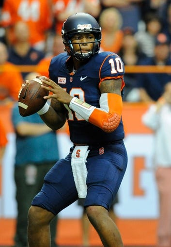Oct 5, 2013; Syracuse, NY, USA; Syracuse Orange quarterback Terrel Hunt (10) drops back to pass during the first quarter against the Clemson Tigers at the Carrier Dome.  Clemson defeated Syracuse 49-14.  Mandatory Credit: Rich Barnes-USA TODAY Sports