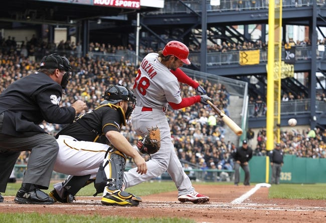Oct 7, 2013; Pittsburgh, PA, USA; St. Louis Cardinals shortstop Pete Kozma (38) at bat against the Pittsburgh Pirates during the third inning in game four of the National League divisional series at PNC Park. The Cardinals won 2-1. Mandatory Credit: Charles LeClaire-USA TODAY Sports