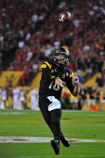 Sep 14, 2013; Tempe, AZ, USA; Arizona State Sun Devils quarterback Taylor Kelly (10) during the game against the Wisconsin Badgers at Sun Devil Stadium. Mandatory Credit: Matt Kartozian-USA TODAY Sports