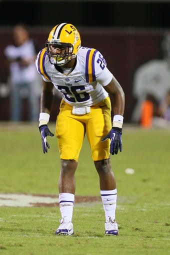 Oct 5, 2013; Starkville, MS, USA; LSU Tigers safety Ronald Martin (26) during the game against the Mississippi State Bulldogs at Davis Wade Stadium.  LSU Tigers defeated the Mississippi State Bulldogs 59-26.  Mandatory Credit: Spruce Derden-USA TODAY Sports