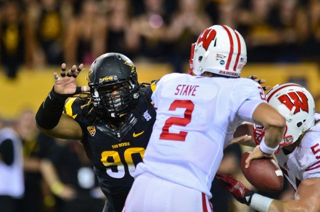 Sep 14, 2013; Tempe, AZ, USA; Arizona State Sun Devils defensive tackle Will Sutton (90) pressures Wisconsin Badgers quarterback Joel Stave (2) during the game at Sun Devil Stadium. Mandatory Credit: Matt Kartozian-USA TODAY Sports