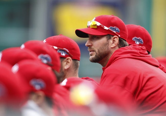 Oct 7, 2013; Pittsburgh, PA, USA; St. Louis Cardinals pitcher Lance Lynn (31) looks on from the dugout against the Pittsburgh Pirates during the fourth inning in game four of the National League divisional series at PNC Park. The Cardinals won 2-1. Mandatory Credit: Charles LeClaire-USA TODAY Sports