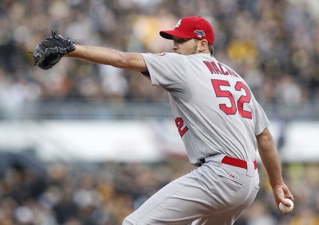 Oct 7, 2013; Pittsburgh, PA, USA; St. Louis Cardinals starting pitcher Michael Wacha (52) pitches against the Pittsburgh Pirates during the eighth inning in game four of the National League divisional series at PNC Park. The Cardinals won 2-1. Mandatory Credit: Charles LeClaire-USA TODAY Sports