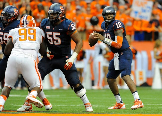Oct 5, 2013; Syracuse, NY, USA; Syracuse Orange quarterback Terrel Hunt (10) drops back to pass during the third quarter against the Clemson Tigers at the Carrier Dome.  Clemson defeated Syracuse 49-14.  Mandatory Credit: Rich Barnes-USA TODAY Sports