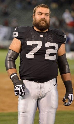 Oct 6, 2013; Oakland, CA, USA; Oakland Raiders offensive lineman Jack Cornell (72) during the game against the San Diego Chargers at O.co Coliseum. The Raiders defeated the Chargers 27-17. Mandatory Credit: Kirby Lee-USA TODAY Sports