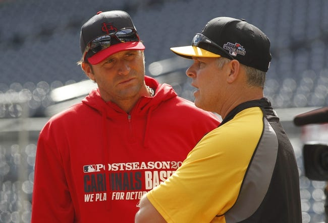 Oct 7, 2013; Pittsburgh, PA, USA; St. Louis Cardinals manager Mike Matheny (left) and Pittsburgh Pirates hitting coach Jay Bell (right) talk on the field before game four of the National League divisional series at PNC Park. The Cardinals won 2-1. Mandatory Credit: Charles LeClaire-USA TODAY Sports
