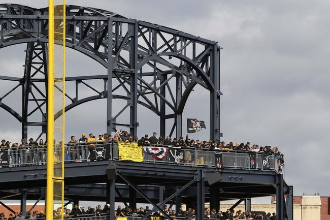 Oct 7, 2013; Pittsburgh, PA, USA; Standing room only crowd stands on the left field rotunda to watch the Pittsburgh Pirates host the St. Louis Cardinals during the fourth inning in game four of the National League divisional series at PNC Park. The Cardinals won 2-1. Mandatory Credit: Charles LeClaire-USA TODAY Sports