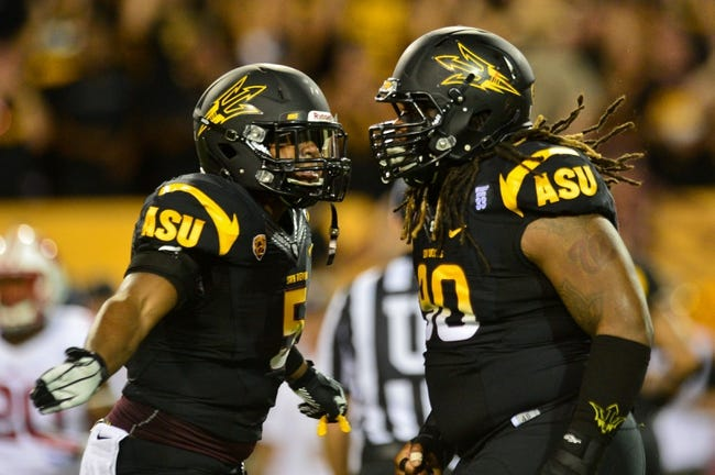 Sep 14, 2013; Tempe, AZ, USA; Arizona State Sun Devils defensive tackle Will Sutton (90) and defensive end Junior Onyeali (5) during the game against the Wisconsin Badgers at Sun Devil Stadium. Mandatory Credit: Matt Kartozian-USA TODAY Sports