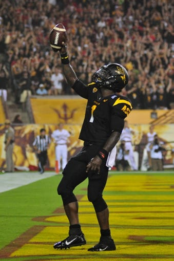 Sep 14, 2013; Tempe, AZ, USA; Arizona State Sun Devils running back Marion Grice (1) scores a touchdown during the game against the Wisconsin Badgers at Sun Devil Stadium. Mandatory Credit: Matt Kartozian-USA TODAY Sports