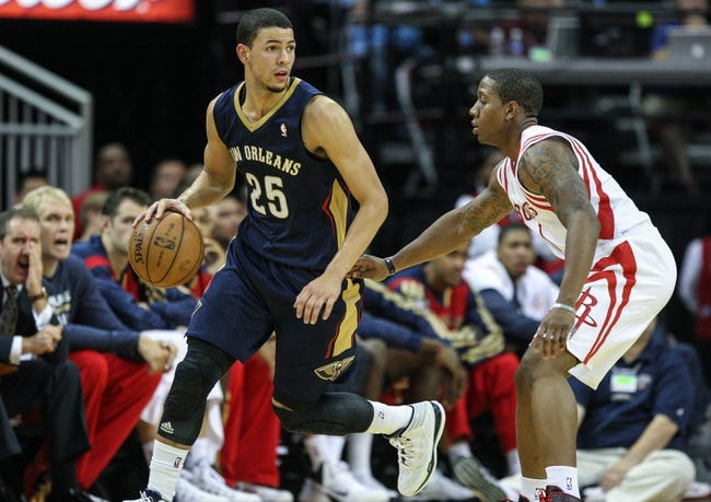 Oct 5, 2013; Houston, TX, USA; New Orleans Pelicans shooting guard Austin Rivers (25) attempts to drive the ball as Houston Rockets point guard Isaiah Canaan (1) defends at Toyota Center. Mandatory Credit: Troy Taormina-USA TODAY Sports