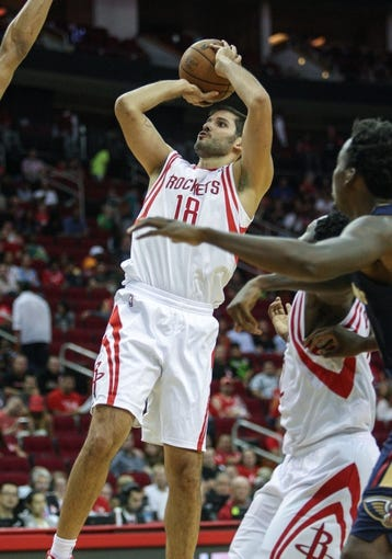 Oct 5, 2013; Houston, TX, USA; Houston Rockets small forward Omri Casspi (18) attempts a shot during the fourth quarter against the New Orleans Pelicans at Toyota Center. The Pelicans defeated the Rockets 116-115. Mandatory Credit: Troy Taormina-USA TODAY Sports