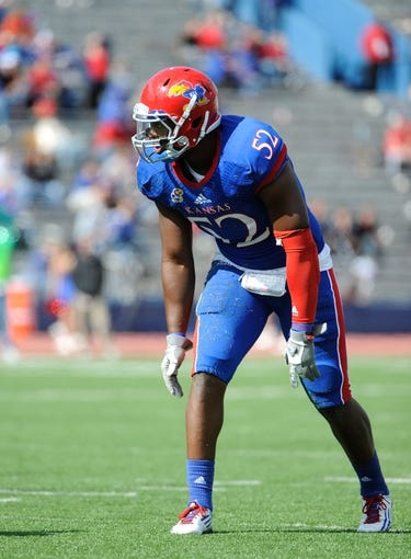 Oct 5, 2013; Lawrence, KS, USA; Kansas Jayhawks linebacker Darius Willis (52) lines up against the Texas Tech Red Raiders in the second half at Memorial Stadium. Texas Tech won the game 54-16. Mandatory Credit: John Rieger-USA TODAY Sports
