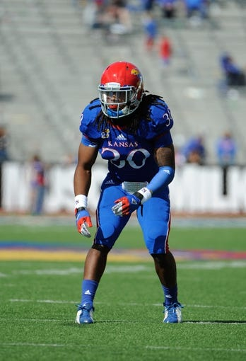 Oct 5, 2013; Lawrence, KS, USA; Kansas Jayhawks safety Tevin Shaw (30) lines up against the Texas Tech Red Raiders in the second half at Memorial Stadium. Texas Tech won the game 54-16. Mandatory Credit: John Rieger-USA TODAY Sports