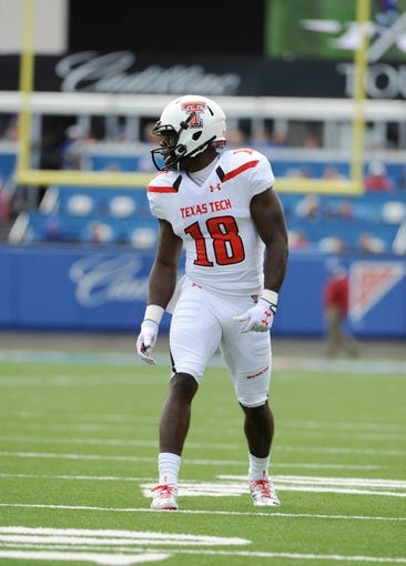 Oct 5, 2013; Lawrence, KS, USA; Texas Tech Red Raiders wide receiver Eric Ward (18) lines up against the Kansas Jayhawks in the first half at Memorial Stadium. Texas Tech won the game 54-16. Mandatory Credit: John Rieger-USA TODAY Sports