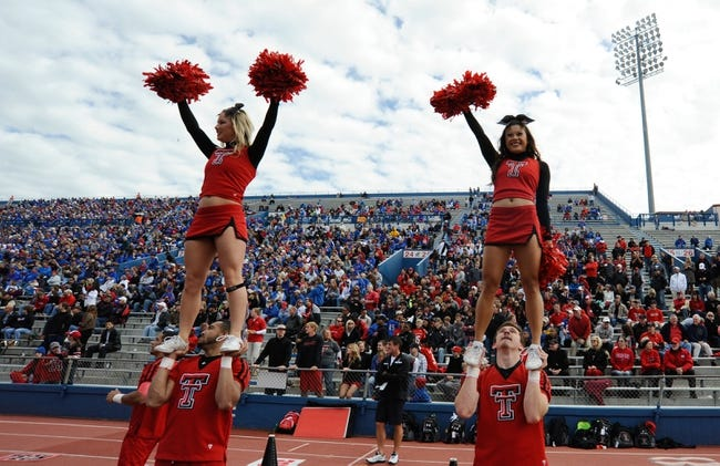 Oct 5, 2013; Lawrence, KS, USA; Texas Tech Red Raiders cheerleaders perform against the Kansas Jayhawks in the first half at Memorial Stadium. Texas Tech won the game 54-16. Mandatory Credit: John Rieger-USA TODAY Sports