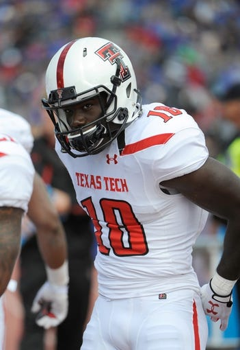 Oct 5, 2013; Lawrence, KS, USA; Texas Tech Red Raiders wide receiver Eric Ward (18) on the sidelines against the Kansas Jayhawks in the first half at Memorial Stadium. Texas Tech won the game 54-16. Mandatory Credit: John Rieger-USA TODAY Sports