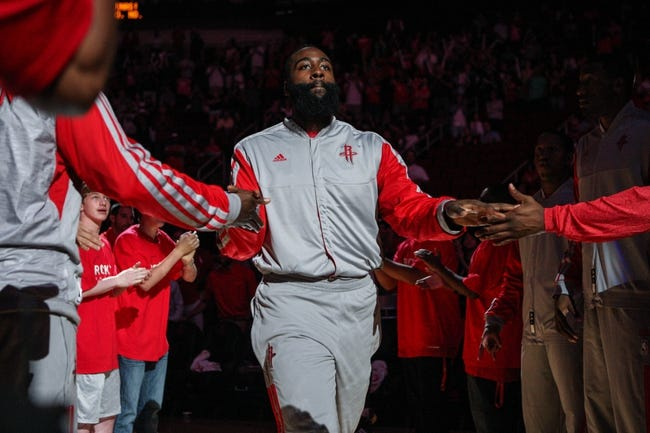 Oct 5, 2013; Houston, TX, USA; Houston Rockets shooting guard James Harden (13) is introduced before a game against the New Orleans Pelicans at Toyota Center. Mandatory Credit: Troy Taormina-USA TODAY Sports