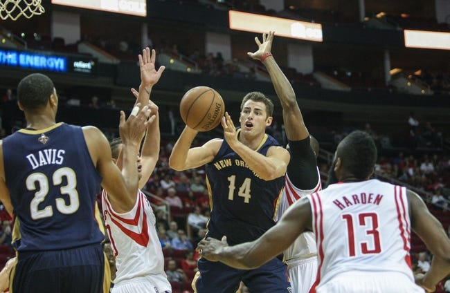 Oct 5, 2013; Houston, TX, USA; New Orleans Pelicans power forward Jason Smith (14) passes the ball during the first quarter against the Houston Rockets at Toyota Center. Mandatory Credit: Troy Taormina-USA TODAY Sports