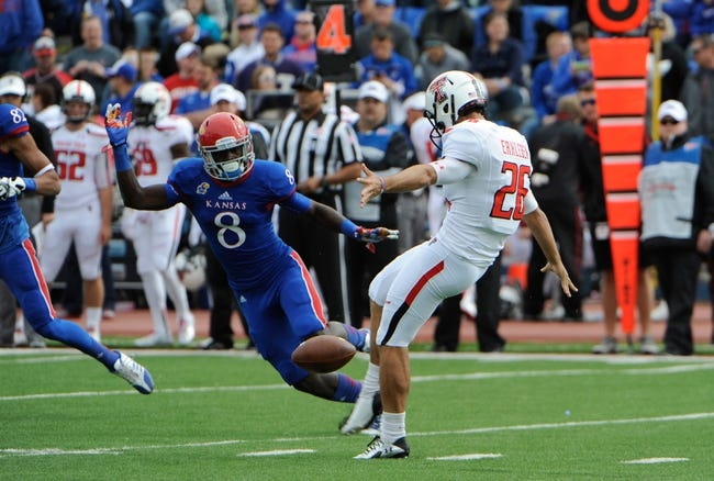 Oct 5, 2013; Lawrence, KS, USA; Texas Tech Red Raiders punter Ryan Erxleben (26) punts against Kansas Jayhawks wide receiver Josh Ford (8) in the first half at Memorial Stadium. Texas Tech won the game 54-16. Mandatory Credit: John Rieger-USA TODAY Sports
