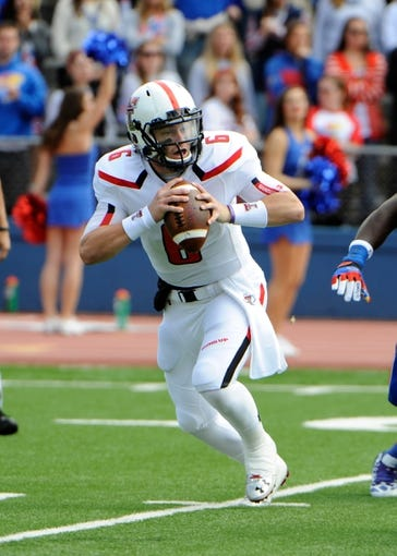 Oct 5, 2013; Lawrence, KS, USA; Texas Tech Red Raiders quarterback Baker Mayfield (6) drops back to pass against the Kansas Jayhawks in the first half at Memorial Stadium. Texas Tech won the game 54-16. Mandatory Credit: John Rieger-USA TODAY Sports
