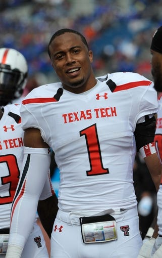 Oct 5, 2013; Lawrence, KS, USA; Texas Tech Red Raiders linebacker Terrance Bullitt (1) on the sidelines in the second half at Memorial Stadium. Texas Tech won the game 54-16. Mandatory Credit: John Rieger-USA TODAY Sports