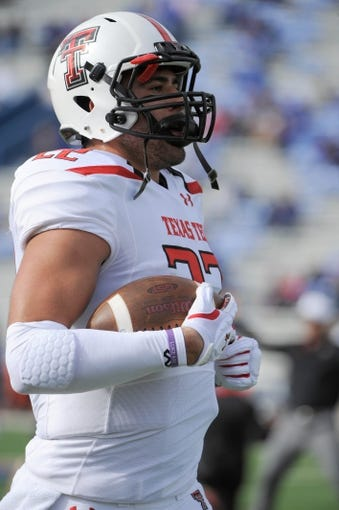 Oct 5, 2013; Lawrence, KS, USA; Texas Tech Red Raiders tight end Jace Amaro (22) warms up before the game against the Kansas Jayhawks at Memorial Stadium. Texas Tech won the game 54-16. Mandatory Credit: John Rieger-USA TODAY Sports