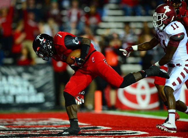 Oct 11, 2013; Cincinnati, OH, USA; Cincinnati Bearcats running back Tion Green (7) is pushed into the end zone by Temple Owls defensive back Zamel Johnson (11) for a touchdown during the first quarterat Nippert Stadium. Mandatory Credit: Andrew Weber-USA TODAY Sports