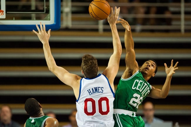 Oct 11, 2013; Newark, DE, USA; Boston Celtics guard Phil Pressey (26) fouls Philadelphia 76ers center Spencer Hawes (00) during the fourth quarter at Bob Carpenter Sports Convocation Center. The Sixers defeated the Celtics 97-85. Mandatory Credit: Howard Smith-USA TODAY Sports