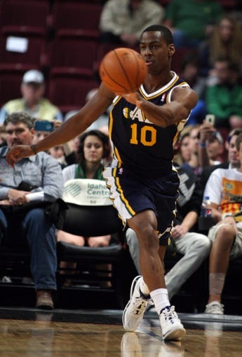 Oct 11, 2013; Boise, ID, USA; Utah Jazz point guard Alec Burks (10) passes the ball during the first half verses the Portland Trail Blazers at CenturyLink Arena. Mandatory Credit: Brian Losness-USA TODAY Sports