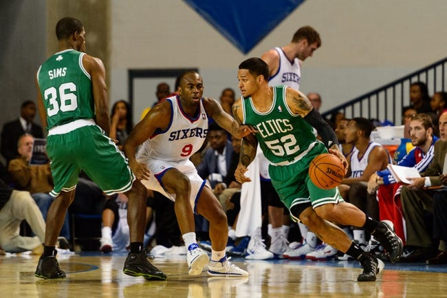 Oct 11, 2013; Newark, DE, USA; Boston Celtics guard Chris Babb (52) is defended by Philadelphia 76ers guard James Anderson (9) during the fourth quarter at Bob Carpenter Sports Convocation Center. The Sixers defeated the Celtics 97-85. Mandatory Credit: Howard Smith-USA TODAY Sports