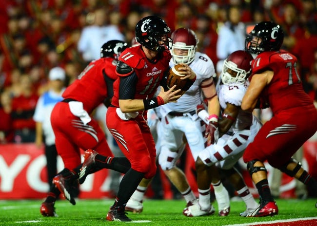 Oct 11, 2013; Cincinnati, OH, USA; Cincinnati Bearcats quarterback Brendon Kay (11) rushes into the end zone for a touchdown during the second quarter against the Temple Owls at Nippert Stadium. Mandatory Credit: Andrew Weber-USA TODAY Sports