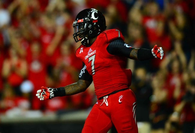Oct 11, 2013; Cincinnati, OH, USA; Cincinnati Bearcats running back Tion Green (7) celebrates after scoring a touchdown during the second quarter against the Temple Owls at Nippert Stadium. Mandatory Credit: Andrew Weber-USA TODAY Sports