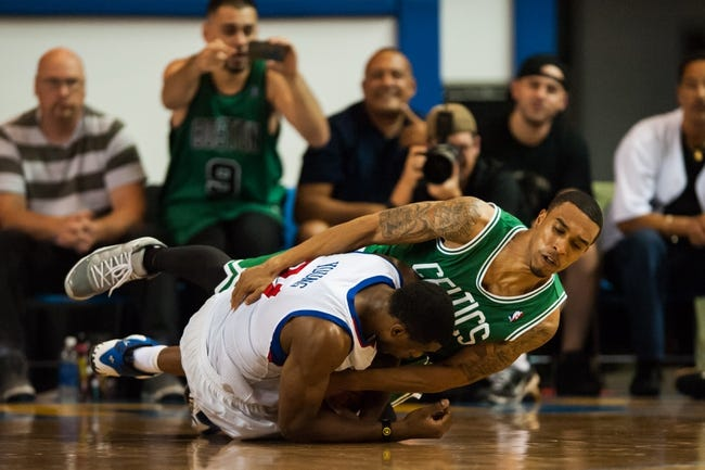 Oct 11, 2013; Newark, DE, USA; Boston Celtics guard guard Courtney Lee (11) and Philadelphia 76ers forward Thaddeus Young (21) scramble for the ball during the fourth quarter at Bob Carpenter Sports Convocation Center. The Sixers defeated the Celtics 97-85. Mandatory Credit: Howard Smith-USA TODAY Sports