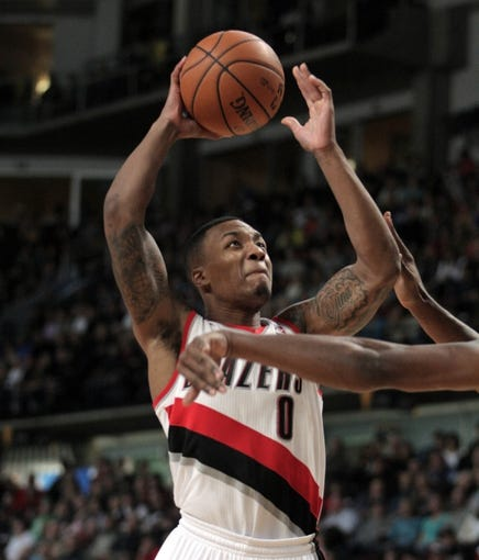 Oct 11, 2013; Boise, ID, USA; Portland Trail Blazers point guard Damian Lillard (0) goes up for a dunk during the first half against the Utah Jazz at CenturyLink Arena. Mandatory Credit: Brian Losness-USA TODAY Sports