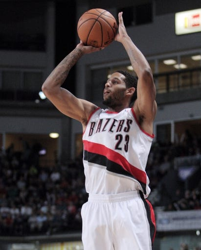 Oct 11, 2013; Boise, ID, USA; Portland Trail Blazers shooting guard Allen Crabbe (23) put up a three point shot during the first half against the Utah Jazz at CenturyLink Arena. Mandatory Credit: Brian Losness-USA TODAY Sports