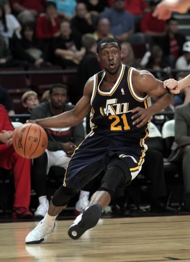 Oct 11, 2013; Boise, ID, USA; Utah Jazz shooting guard Ian Clark (21) drives to the basket during the second half verses the Portland Trail Blazers at CenturyLink Arena. Portland beat Utah 96-86. Mandatory Credit: Brian Losness-USA TODAY Sports