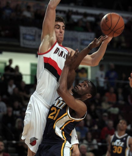 Oct 11, 2013; Boise, ID, USA; Utah Jazz shooting guard Ian Clark (21) attempts a shot over Portland Trail Blazers small forward Victor Claver (18) during the fourth quarter at CenturyLink Arena. Portland beat Utah 96-86. Mandatory Credit: Brian Losness-USA TODAY Sports
